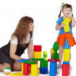 Stock Photo: Mom plays with daughter