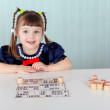 Child at table played with bingo — Stock Photo