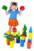 Cheerful girl playing with colored blocks — Stock Photo