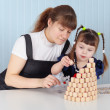 Mother and daughter building tower of bingo — Stock Photo #2392347