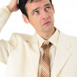 Puzzled man scratches his head, isolated — Stock Photo