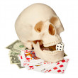 Human skull, playing cards and money — Stock Photo