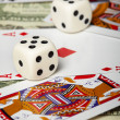 Dice against of playing cards and money — Stock Photo