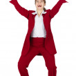 Jubilant woman in red business suit — Stock Photo