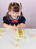 Child plays with toys at table — Fotografia Stock