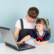 Mother and daughter with a laptop — Stock Photo #2480703