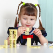 Child playing with dominoes at table — Stock Photo #2480876
