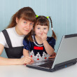 Mother and daughter with computer — Stock Photo