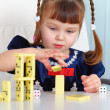 Child playing with dominoes — Stock Photo