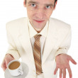 Young man in white suit with coffee — ストック写真