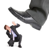 Big foot of crisis crushes entrepreneur — Stock Photo