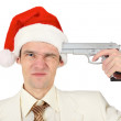 Man in Christmas hat tries to shoot — Stock Photo #2665824