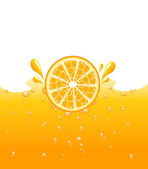 Orange falling into the orange juice — Stock Photo