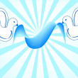 White doves holding blue ribbon — Stockfoto