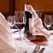Served table with red wine at restaurant - Stock Photo