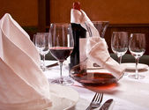 Served table with red wine at restaurant — Foto Stock