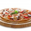 Pizza on a wooden plate — Stock Photo