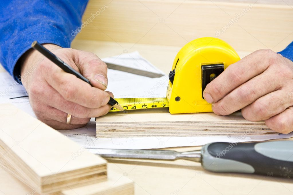 Hands carpenter working with tools — Stock Photo #1018619