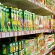 Shelves with juices in a supermarket. — Stock Photo #1037494