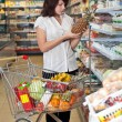 Beautiful young woman in supermarket — Stock Photo #1037614