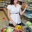 Happy young woman in supermarket — Stock Photo #1037633