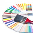 Paint brush on color guide - Stok fotoğraf