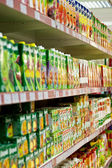 Shelves with juices in a supermarket. — Stock Photo