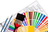 Paint roller, pencils, drawings — Stock Photo