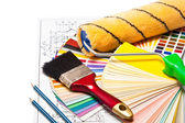 Paint roller, pencils on drawings — Stock Photo