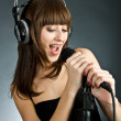 Royalty-Free Stock Photo: Woman  Singing in Microphone