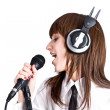 Woman  Singing in Microphone — Stock Photo