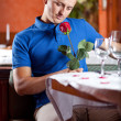Man expecting girlfriend at restaurant — Stock Photo