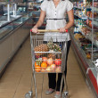 Beautiful young woman in supermarket — Stock Photo #1071636