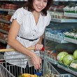 Stock Photo: Young woman in supermarket