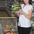 Female customer holding a watermelon — Stock Photo