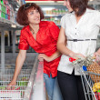 Two customers in supermarket — Stock Photo