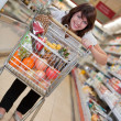 Young woman in the supermarket — Stock Photo #1071907