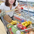 Young woman in the supermarket — Stock Photo