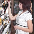 Stock Photo: Young woman in wine shop