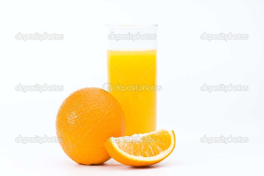 Orange with juice in the glass — Stock Photo #1079199