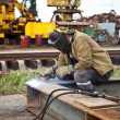 Stock Photo: Worker-welder in protective mask