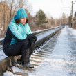 Stock Photo: The woman sitting on rails