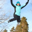 Young woman in the winter jump — Stock Photo