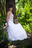 The bride with a bunch of flowers — Stock Photo