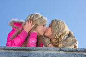 Two blonde girlfriend kissing — Stock Photo