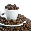 Cup of coffee, full of beans. — Stock Photo