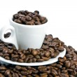 Cup of coffee, full of beans. — Stock Photo #1099090