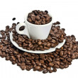 Cup of coffee, full of beans. — Stock Photo #1099114