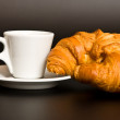 White cup coffee and croissant on black — Stock Photo