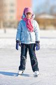 Girl on skates at the skating rink — Stock Photo